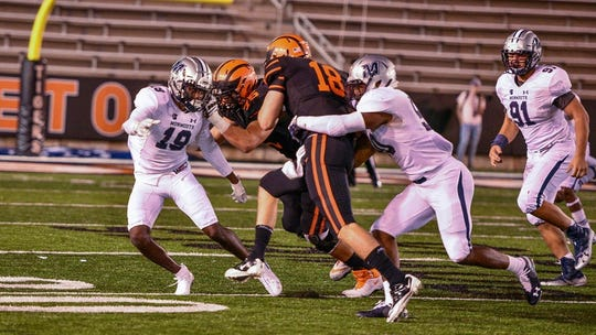 Monmouth defenders converge on a Princeton receiver in a Sept. 22 game at Princeton.n