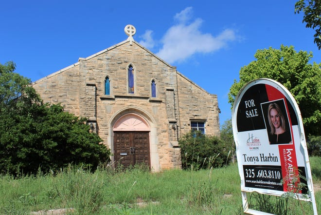 A for sale sign is seen in front of a former church on Hickory Street in north Abilene. It's one of several former church properties on the market.