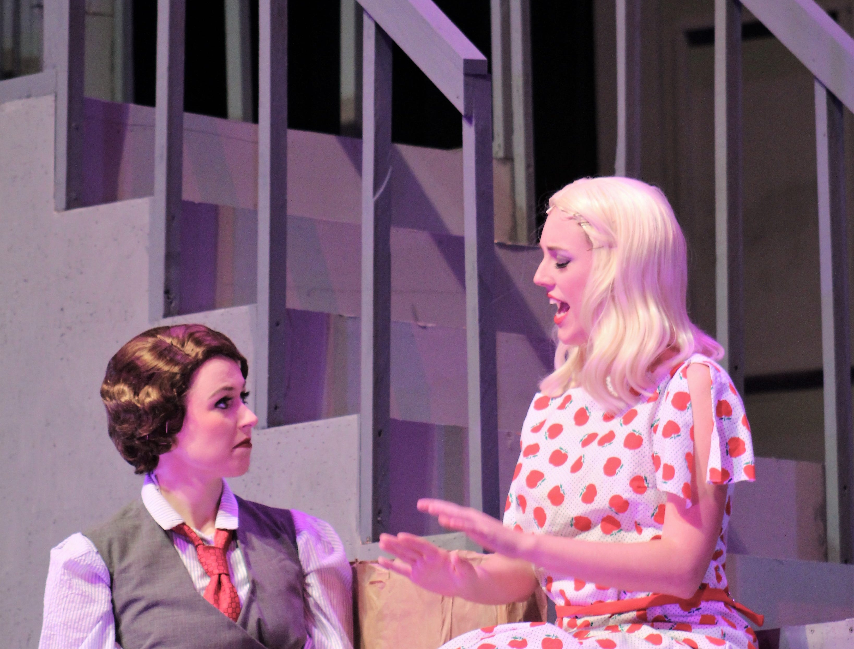 """Ruth (Payton Reeves, left) and her sister Eileen Sherwood (Helena Lynch) talk about their day on the stoop of their basement apartment in this rehearsal scene from """"Wonderful Town,"""" Abilene Christian's 2018 homecoming musical."""