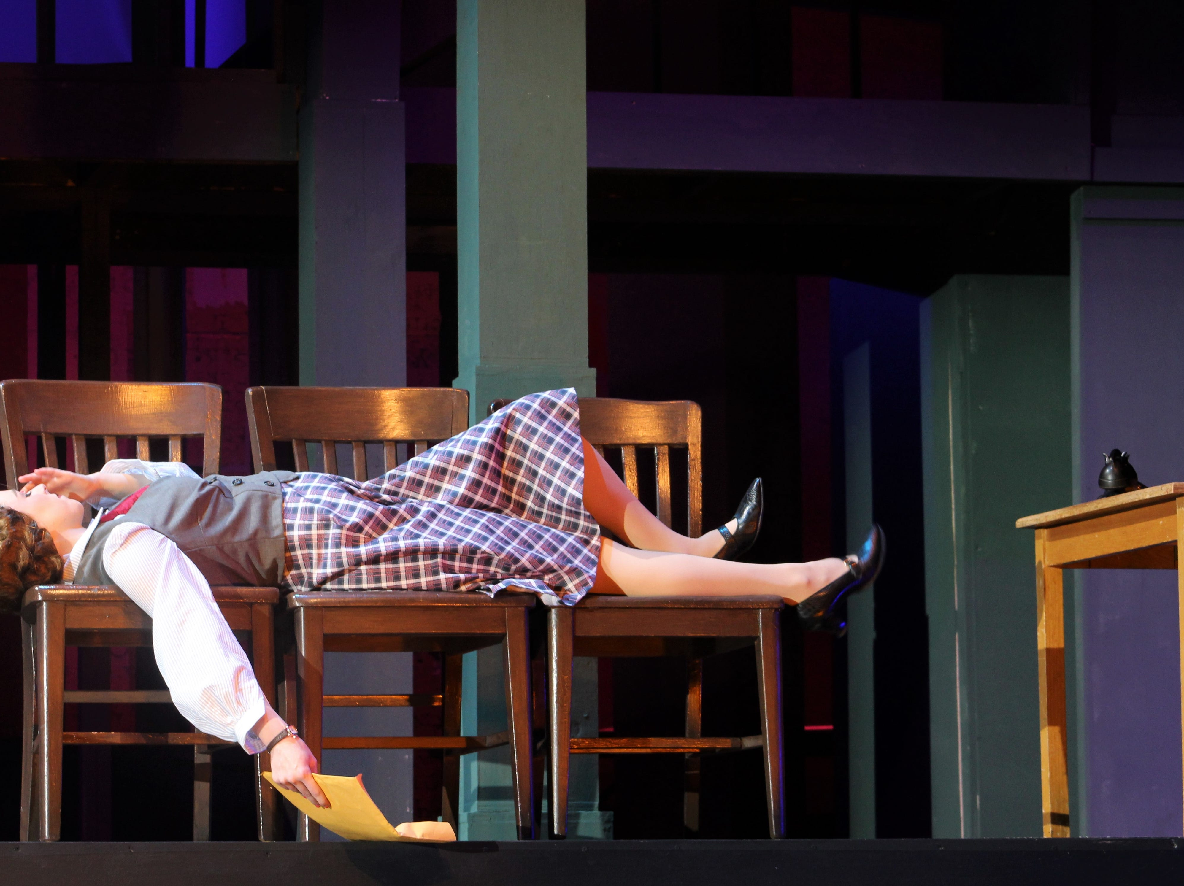 """Ruth Sherwood (Payton Reeves) reclines on vacant chairs after not getting her job interview in this rehearsal scene from """"Wonderful Town,"""" Abilene Christians' 2018 homecoming musical."""
