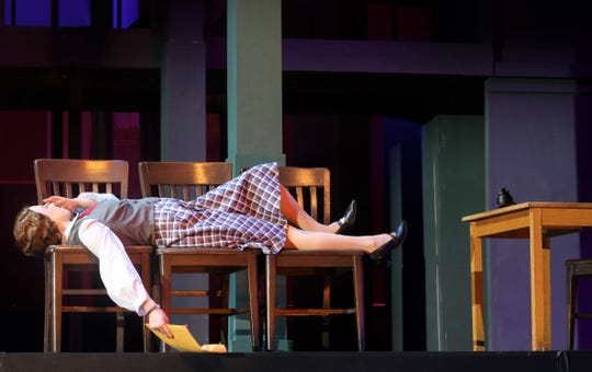 """Ruth Sherwood (Payton Reeves) reclines on vacant chairs after not getting her job interview in this rehearsal scene from """"Wonderful Town,"""" Abilene Christian's homecoming musical."""