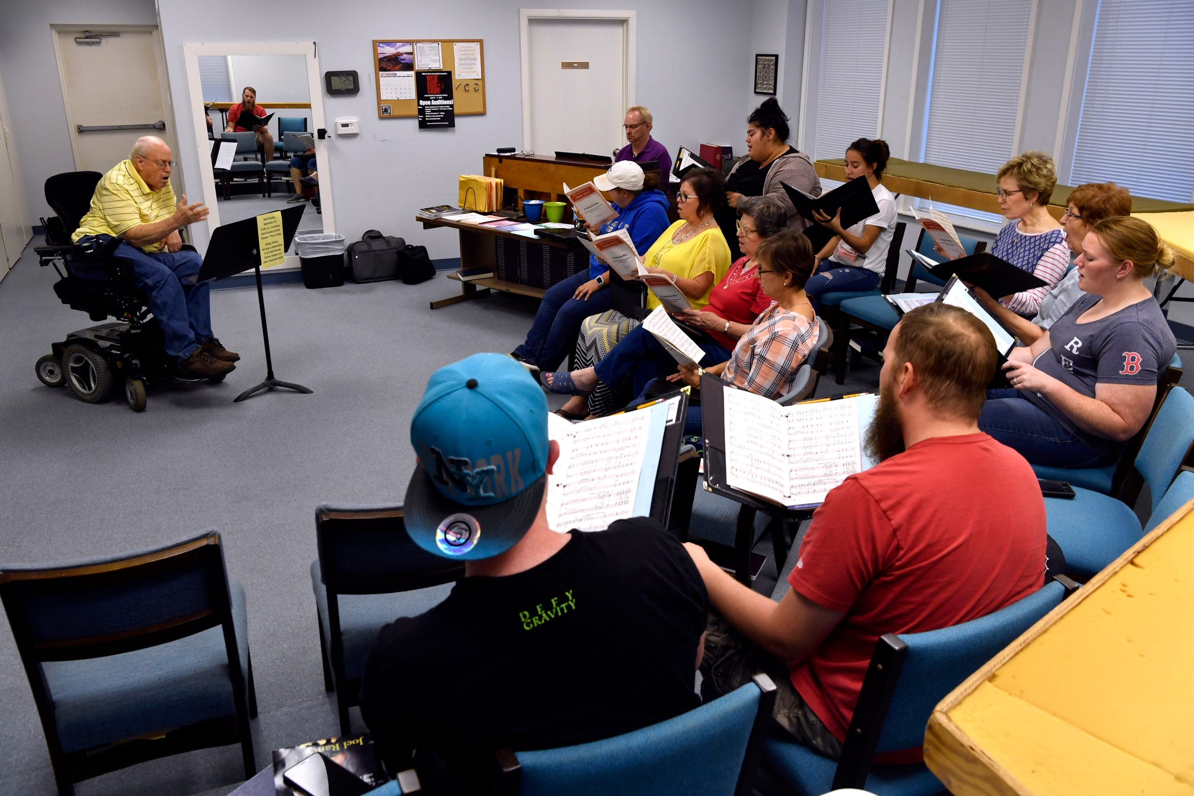 Joe Hill leads the First Christian Church Chancel Choir on Sept. 19 during practice. The building is one of several church properties listed for sale in Abilene.