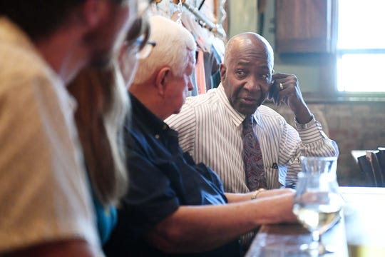 Rev. Dr. L.C. Ray talks with fellow tenants of the Flatiron Building as they express their concern over major renovation plans have been submitted for one of the city's most recognizable structures during a meeting at Jack of the Wood Oct. 8, 2018.