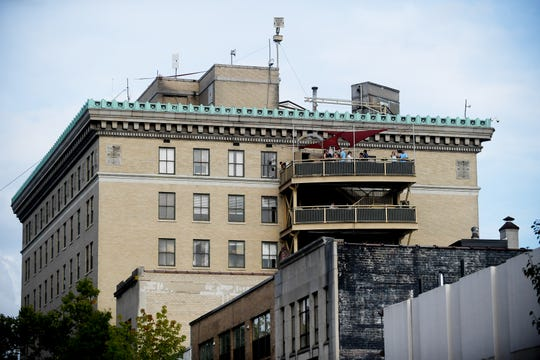 A distant view of the Skybar in Asheville historic Flatiron building.