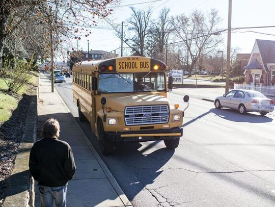 Buncombe has about 24,000 students, of which about 13,000 ride buses. Asheville City Schools has about 4,300 students, with just over 1,500 bus riders.