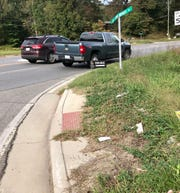 The ADA-compliant ramps at Jims Branch Road and U.S. 70 have become overgrown with weeds and do not lead to sidewalks. The local DOT office has changed its policy on installing the ramps where they don't lead to sidewalks.