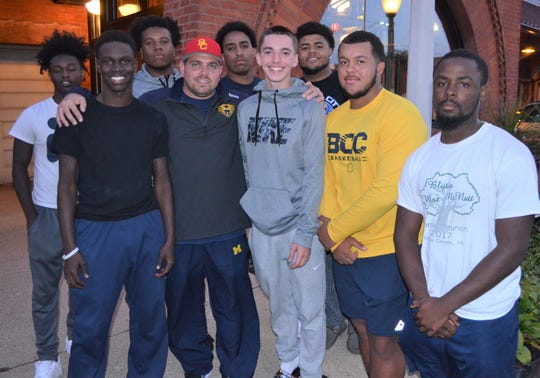 Originally an idea to have dinner with one of his players John Love, Battle Creek Central assistant football coach Casey Bess, center, has created 'Tuesdays with Coach Bess' and brought 7-15 players each week to have dinner at Clara's in downtown Battle Creek.