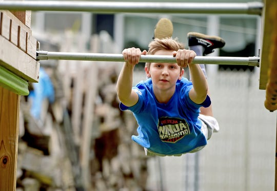 Evan Wenzinger of Vestal works out on his backyard gym on Monday, October 8, 2018. Evan, an eight-grade student at Seton Catholic Central, will appear on the reality television show American Ninja Warrior Junior, which debuts on Universal Kids network on October 13.