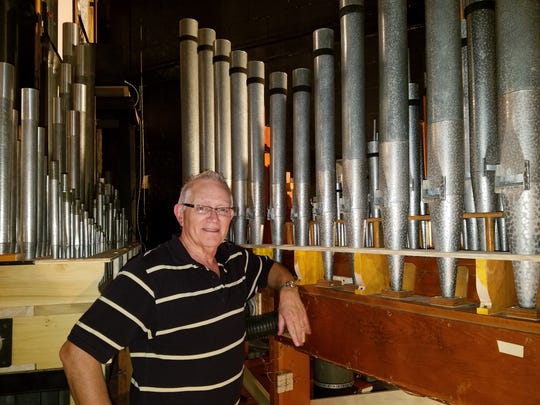 Tom Taylor stands among the pipes of the newly restored 1924 Hook & Hastings pipe organ at Suntree United Methodist Church.  The public is invited to the pipe organ dedication concert, Music for All Reasons.