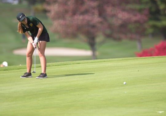 Burr and Burton's Julia Dapron rolls a birdie putt on the par-3 12th hole during the 2018 high school girls golf state championships at Ralph Myhre Golf Course in Middlebury on Tuesday.