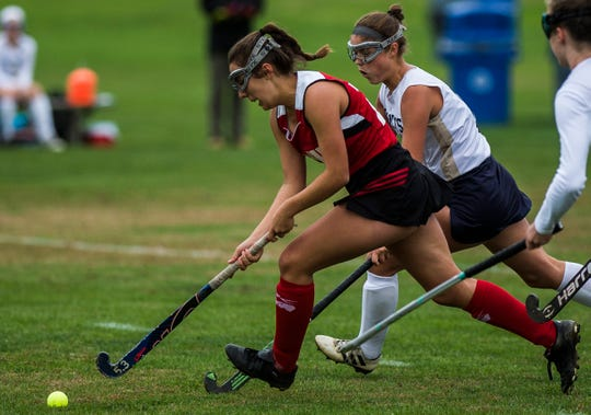 CVU #20 Lena Ashooh breaks away with the ball during their high school field hockey game at Essex High School on Monday, Oct. 8. 2018. Essex won, 2-1.