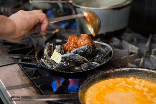Owner and chef Joe Scarpinato prepares a dish with wild caught mussels at Scarpinato's in Turnersville, N.J.