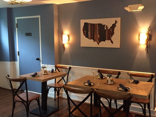 A four- and two-seat dining table awaits guests at Denim American Bistro.
