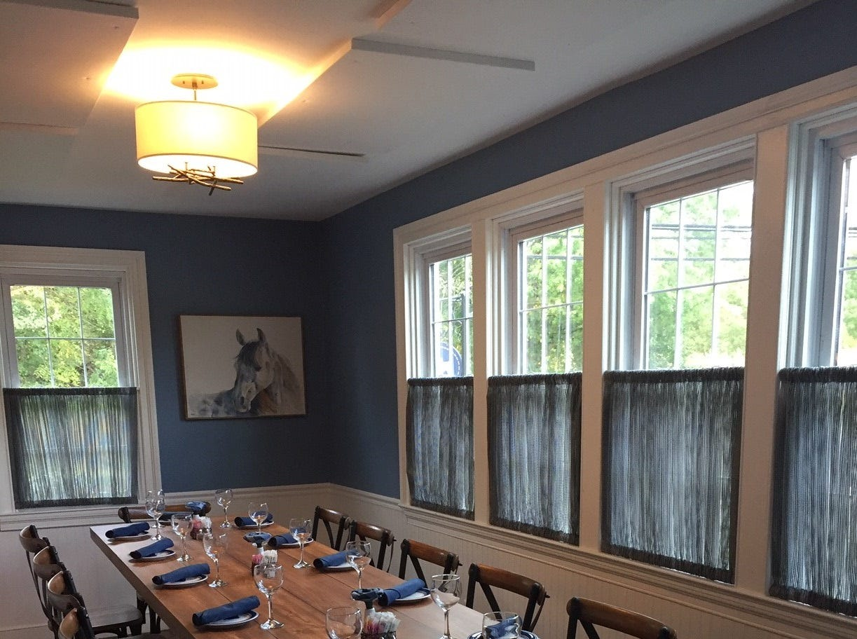 A communal table is set up for guests at Denim American Bistro in Cherry Hill. The restaurant was most recently The Farmhouse, and prior to that was the long-shuttered La Campagne.