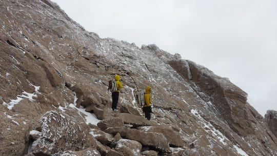 Members of a search and rescue team on Saturday look for Ryan Albert, a Marlton man reported missing on Longs Peak in Colorado.