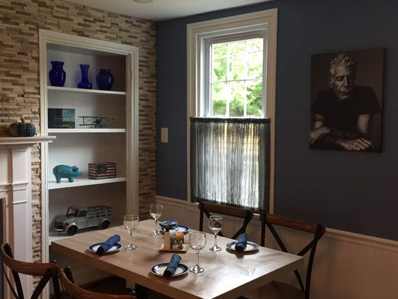 A portrait of Anthony Bourdain by Miller Mobley hangs in the rear of a dining room at Denim American Bistro in Cherry Hill. It has since been moved to a communal dining area in the front of the restaurant, which is about to host an Anthony Bourdain dinner in his memory.