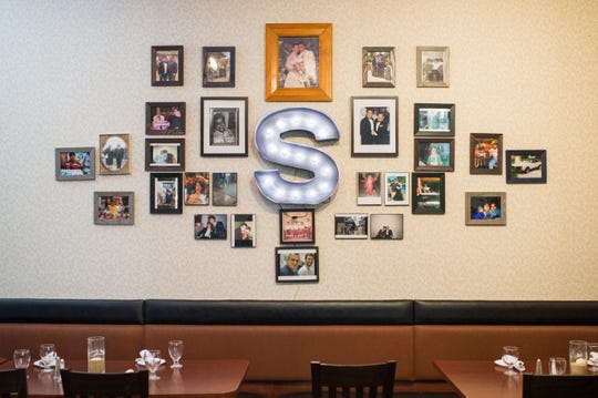 A wall of family pictures inside Scarpinato's in Turnersville, N.J.