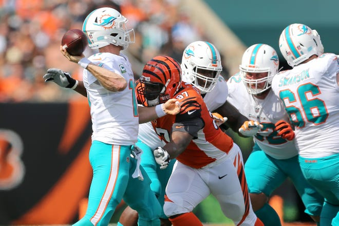 Cincinnati Bengals defensive tackle Geno Atkins (97) pressures Miami Dolphins quarterback Ryan Tannehill (17) as he throws during the Week 5 NFL game between the Miami Dolphins and the Cincinnati Bengals, Sunday, Oct. 7, 2018, at Paul Brown Stadium in Cincinnati.