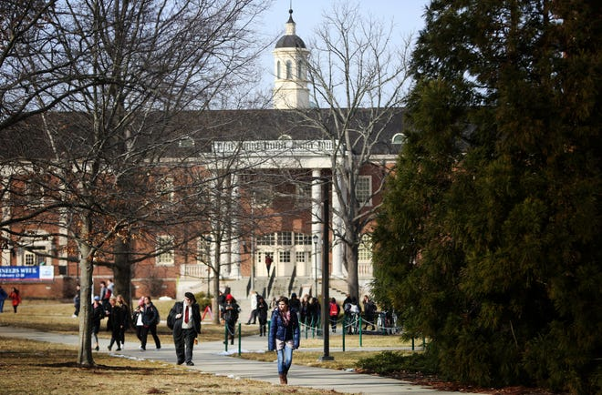 Students walk near the College of Engineering and Computing on Miami University's campus.