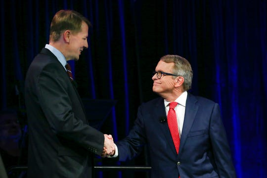 Democratic gubernatorial candidate Richard Cordray, left, and Ohio Attorney General and Republican gubernatorial candidate Mike DeWine shake hands before a debate at Cleveland State University on Monday.