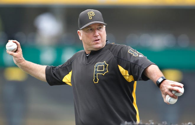 Aug 7, 2017; Pittsburgh, PA, USA;  Pittsburgh Pirates bench coach Tom Prince (14) throws batting practice before playing the Detroit Tigers at PNC Park. Mandatory Credit: Charles LeClaire-USA TODAY Sports