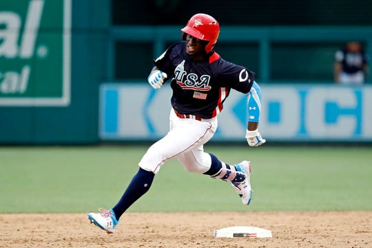 Jul 15, 2018; Washington, DC, USA; USA infielder Taylor Trammell (5) hits a triple in the eighth inning against the World Team during the 2018 All Star Futures Game at Nationals Ballpark. Mandatory Credit: Geoff Burke-USA TODAY Sports
