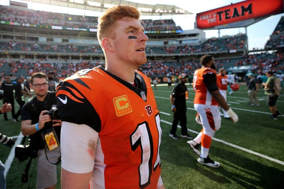Cincinnati Bengals quarterback Andy Dalton (14) looks to shake hands with the Miami Dolphins after the 27-17 win , Sunday, Oct. 7, 2018, at Paul Brown Stadium in Cincinnati.