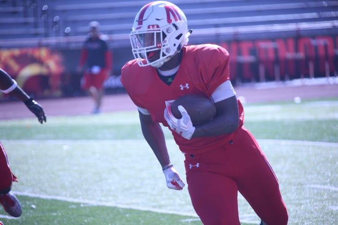 Austin Peay running back Kentel Williams runs around the left side of the field during kickoff return drills during practice Tuesday.