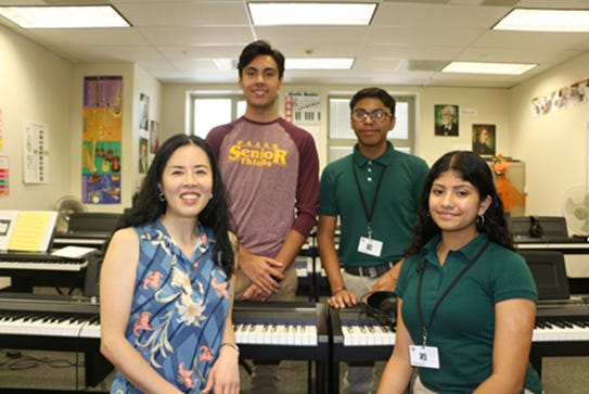 PAAAS students to perform at New Jersey Boards convention in Atlantic City. Left to right: Sang Lee, director of the piano studio, Brian Bejarano, Etbaal Hernandez and Alliss Alas.