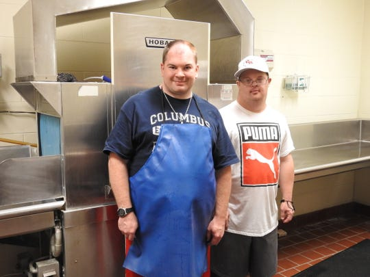"""Corey Minor and Zach Gonter are cousins who in the dish room of the Coshocton County Career Center. Corder said he would encourage others to work along side them if the opportunity arose.""""It's like the best job,"""" he said."""