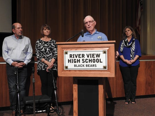 "Cordell Brown addresses viewers of the film ""Thriving with Cerebral Palsy"" during a recent screening at River View High School. Behind him are Gary Johns, Tina Johns and Betty Jo Russell."