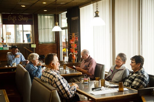 "Miriam Welch, second from right, sits and talks with friends who stopped in for lunch at Boondocks Cafe on Tuesday, Oct. 9, 2018 in Williams. Miriam and husband Bob built and have run the iconic truck stop along I-35 since 1973 but will be closing the doors on Oct. 20. ""There are definitely things we are going to miss,"" said Miriam adding that the people they have met and befriended through the business have been one reason they have kept it open so long."