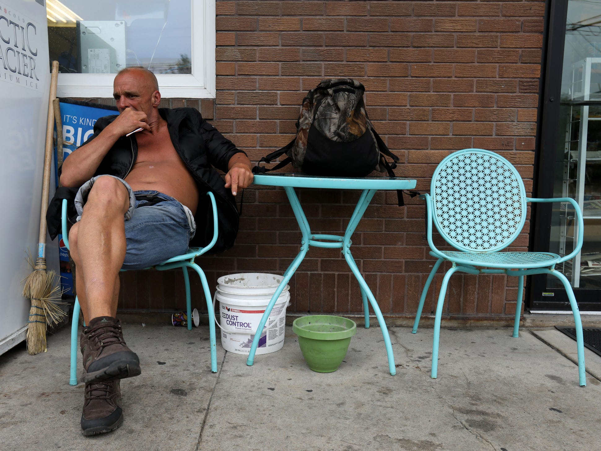 Joe Murphy cleans his teeth with a straw while relaxing at Luby's Food Store in Kenora, Ontario, Canada. Luby's, a convenience store is one of the places Murphy likes to hang out at.