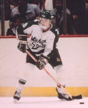 Joe Murphy looks to pass off the puck during his playing days at Michigan State in 1986.