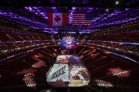 Images and logos are projected onto the ice and seating in the Little Caesars Arena in downtown Detroit on Wednesday September 6, 2017.