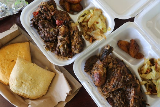 From left: Jamaican patties, brown stew chicken and jerk chicken from Delphine's Jamaican Restaurant in Warren.
