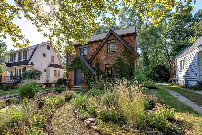 This classic brick Tudor in northwest Ferndale includes a living room with built in bookshelves, a formal dining room, cove ceiling, crown molding, good sized bedrooms and hardwood floors throughout.