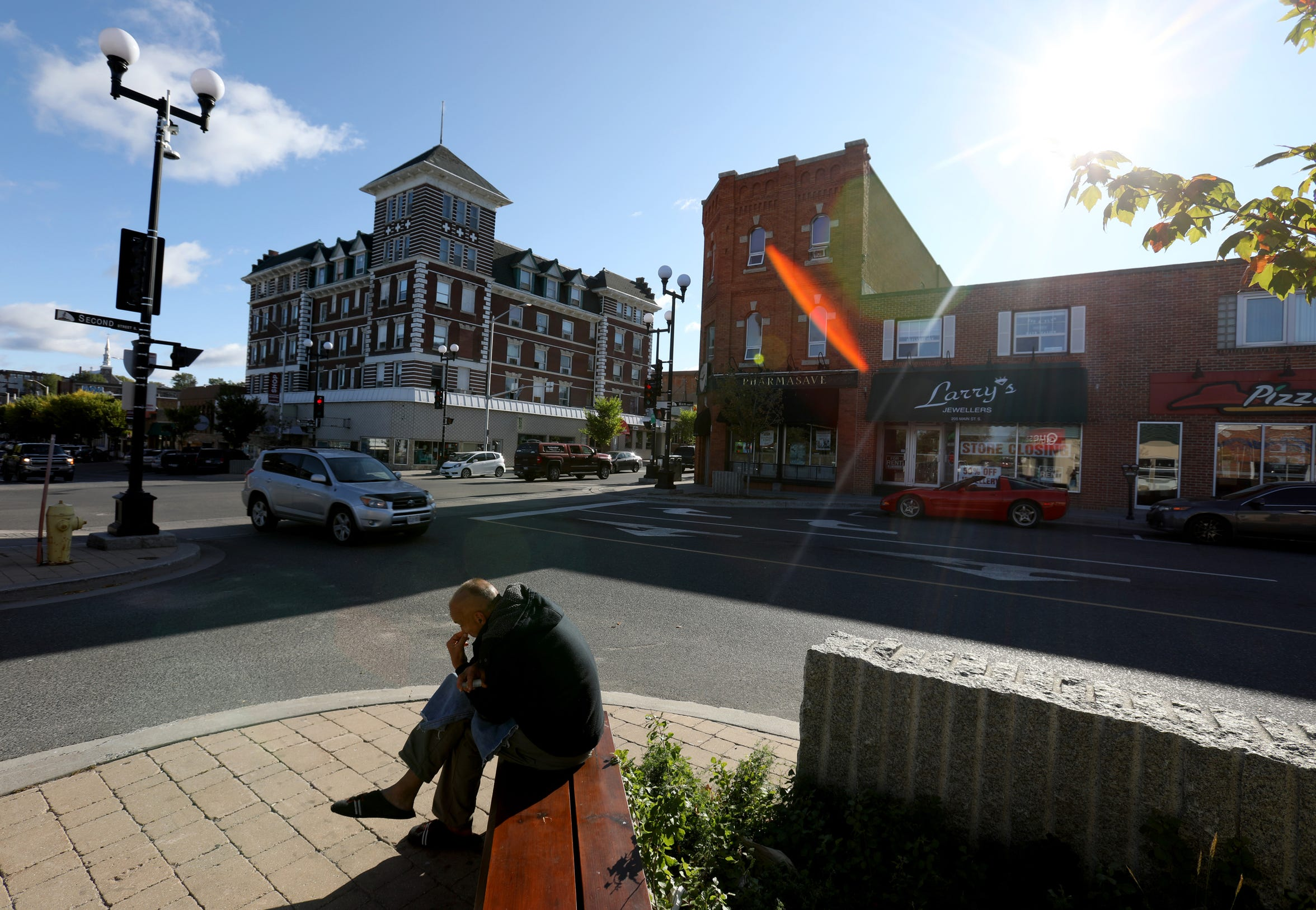 Joe Murphy sits on a bench in the heart of downtown Kenora, Ontario, Canada.