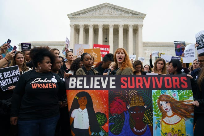 Protesters with Women's March and others gather in front of the Supreme Court on Capitol Hill in Washington Sept. 24, 2018.