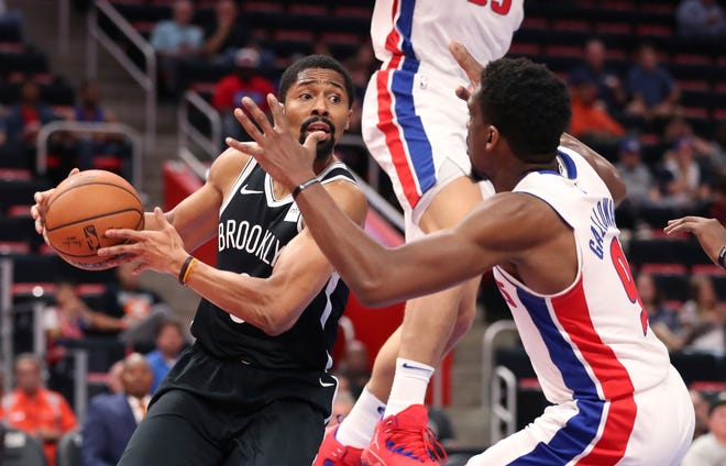 Brooklyn Nets guard Spencer Dinwiddie looks to pass around Detroit Pistons guard Langston Galloway during the first half of a preseason game, Monday, Oct. 8, 2018, in Detroit.