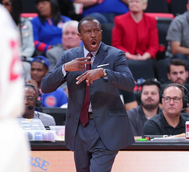 Pistons coach Dwane Casey signals during action against the Nets, Monday at Little Caesars Arena.