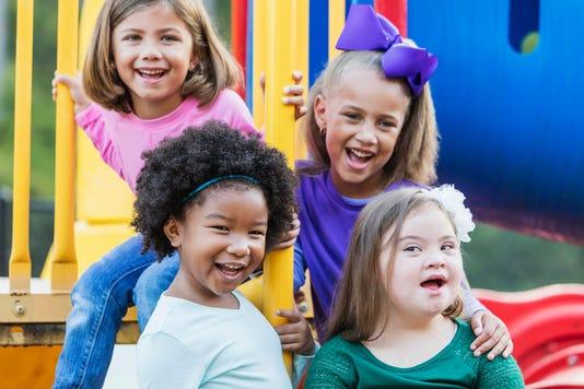 Multi Ethnic Girls Playing On Playground