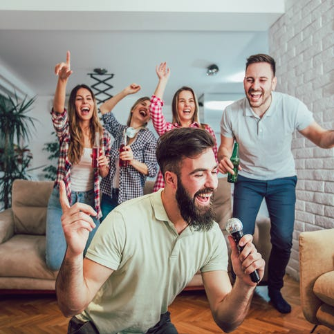 Extrovert wants to host parties without stressing introvert spouse