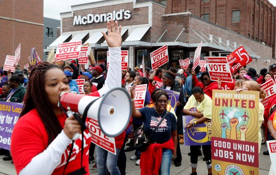 Protesters rally in front of a McDonald's restaurant, Tuesday, Oct. 2, 2018, in Detroit. The group of protesters were calling for higher pay and the right to form unions in Michigan.