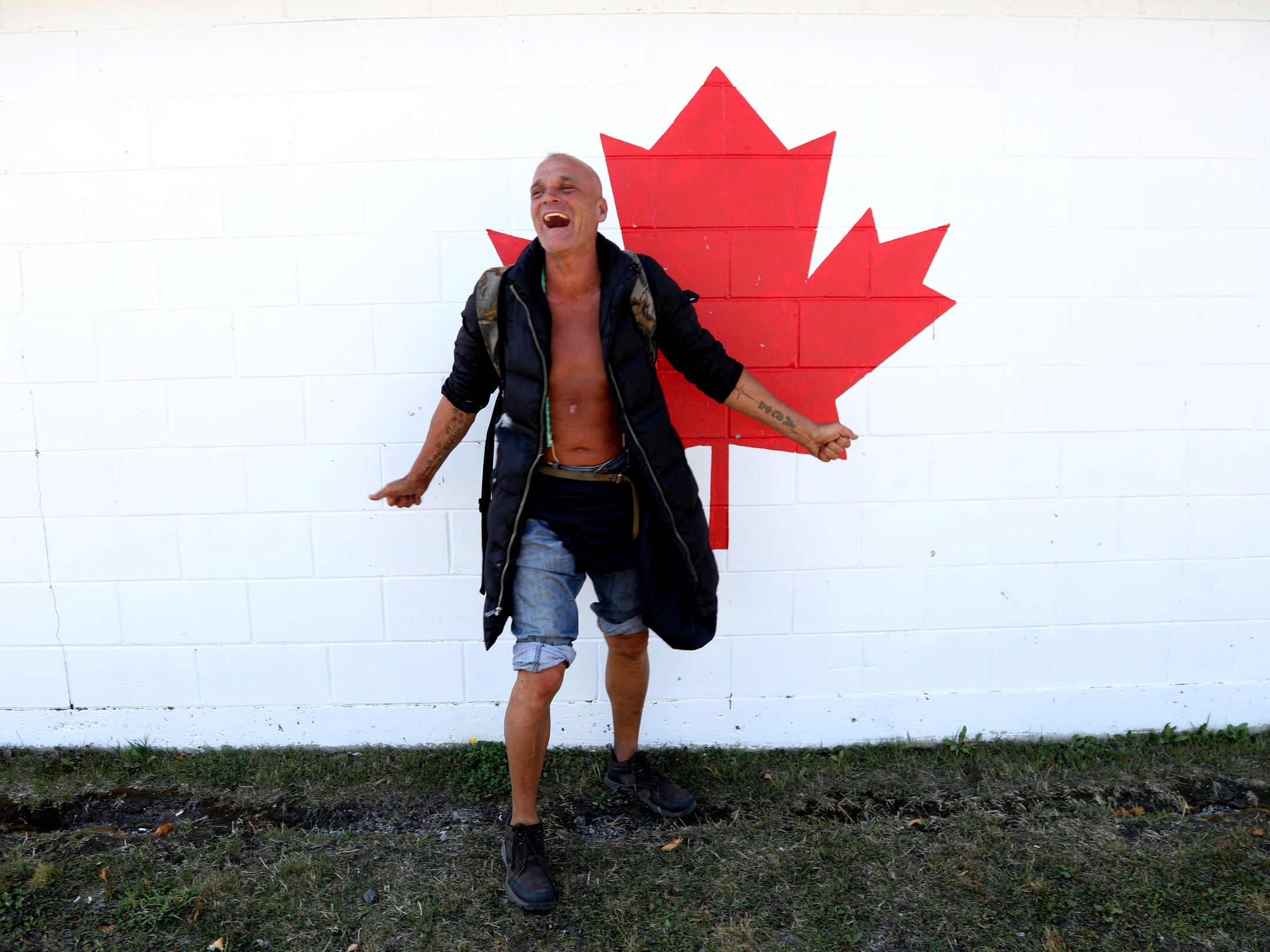 Joe Murphy has a laugh behind a baseball dugout in Kenora, Ontario, Canada. Murphy who played for the Detroit Red Wings from 1986 to 1990 before being traded to the Edmonton Oilers, has been homeless and  living in Kenora.