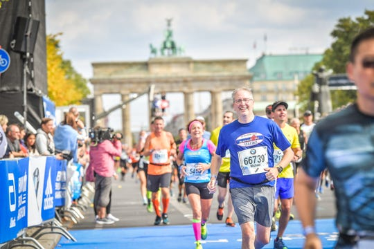 Mike Silvio of Livonia ran the BMW Berlin Marathon in September 2018, a decade after he started running to find relief from auto industry stress.