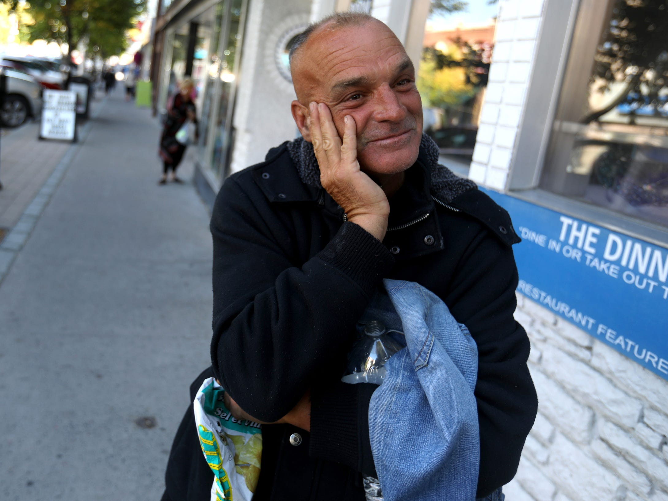 Joe Murphy smiles while looking down the sidewalk in downtown Kenora, Ontario, Canada on Wednesday, September 4, 2018.