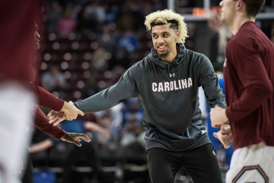 The father of former blue-chip basketball recruit and Saginaw native Brian Bowen (pictured) testified on Tuesday that former Michigan wide receiver Tai Streets paid him $5,000.