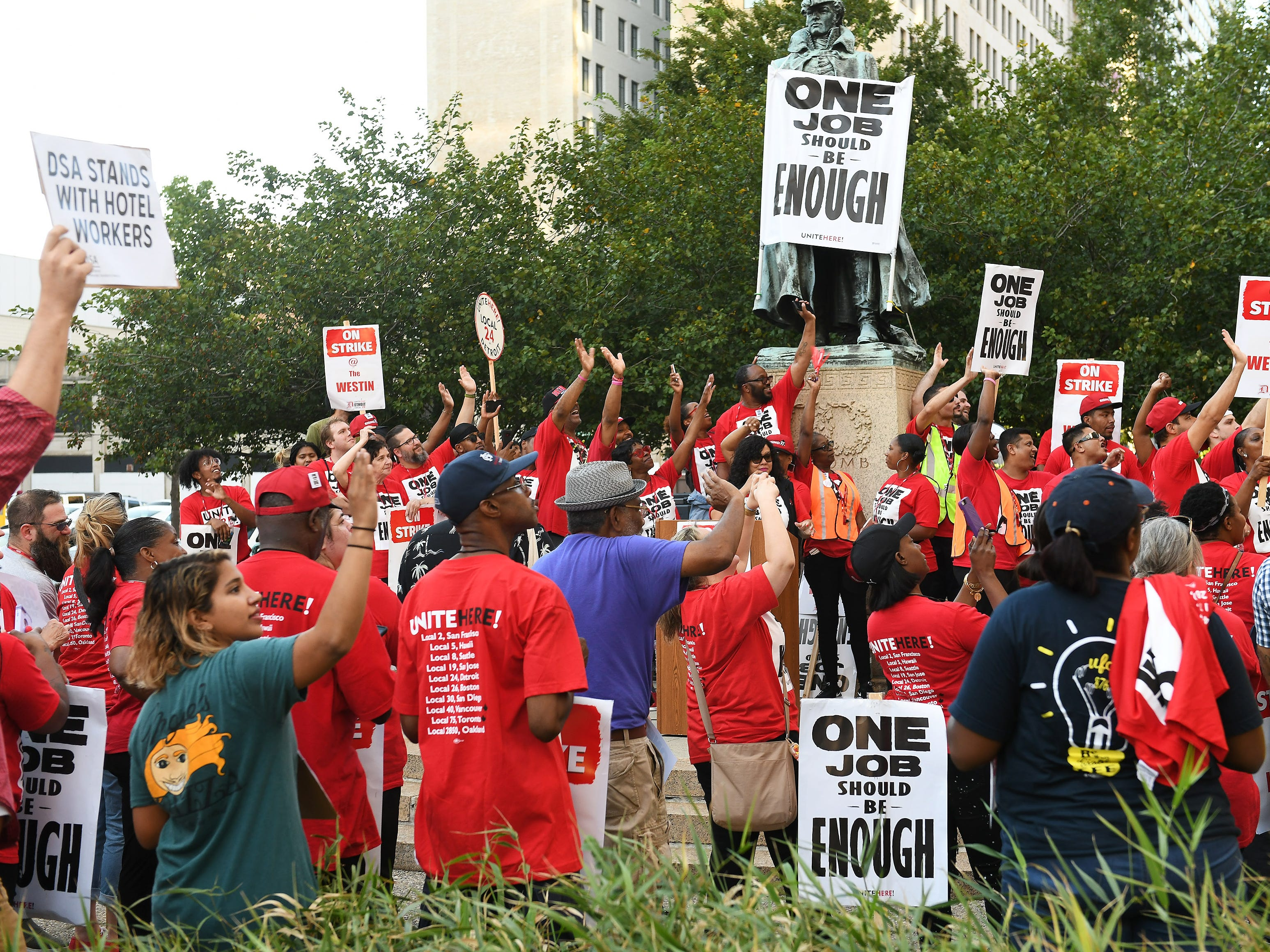 Workers and supporters wave toward the Westin Book Cadillac during a rally across the street from the hotel. Workers from Unite Here Local 24 went on strike Sunday at the Westin Book Cadillac in downtown Detroit.