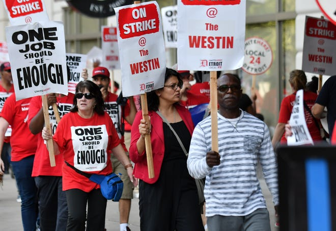 Democratic Congressional candidate Rashida Tlaib, center, marches on the packed picket line with workers before a rally. Workers from Unite Here Local 24 on strike at the Westin Book Cadillac in Detroit on Oct 9, 2018.